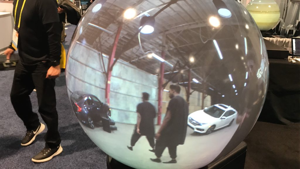 Honda ad being shown on a Magic Planet VR Globe
